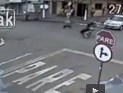 Dude Does A Sick Wheelie Through An Intersection And His Motorcycle Runs Away From Him