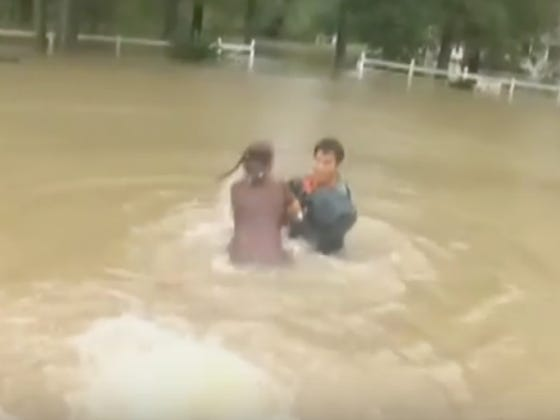 This Footage Of A Guy Saving A Woman And Her Dog From The Louisiana Floods Is INSANE