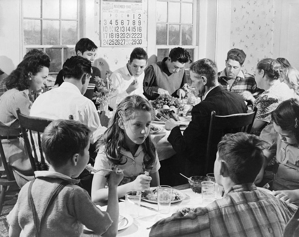 Families Eating Thanksgiving Dinner
