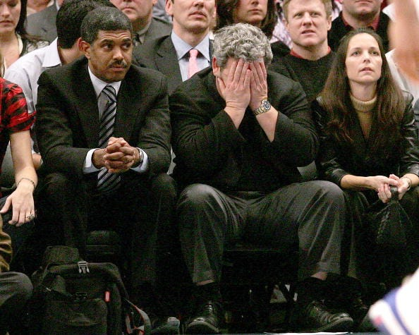 James Dolan has his head in his hands during the 1st half of