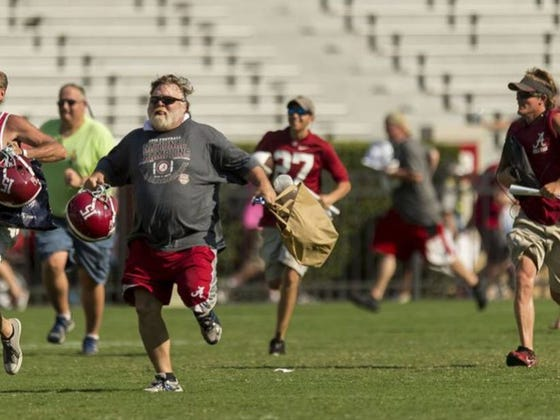 Is There Anything More American Than Adult Bama Fans Running For College Kids' Autographs?