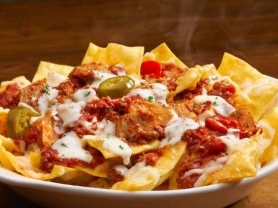 Olive Garden Now Has NACHOS Topped With Meat And Alfredo Sauce...Mama Mia!