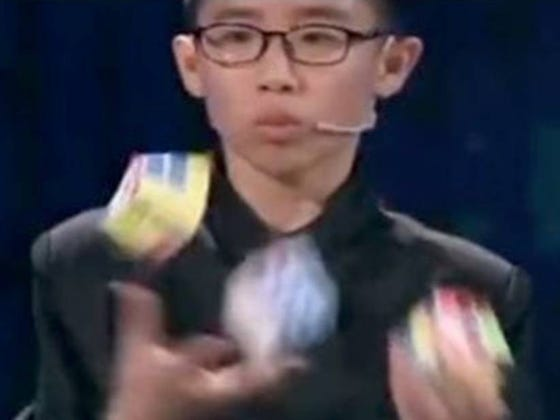 12-Year-Old Solves 3 Rubiks Cubes At Once While Juggling Them