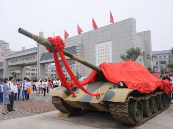 Chinese School Parks Military Tanks Outside To Motivate Students