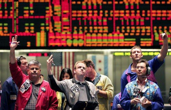 Dow Closes Just Below Record High