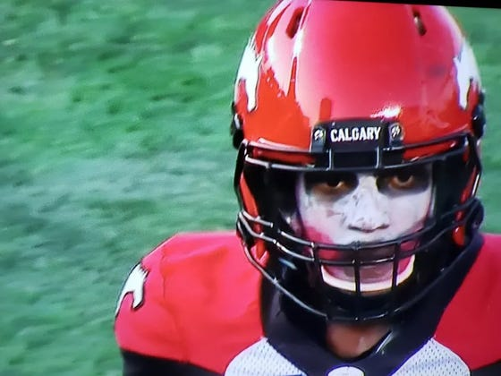 CFL DB Plays With Terrifying Joker Face Paint, Immediately Gets Interception